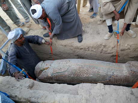 This photo released on Thursday, Feb. 13, 2014 by Egypt's Supreme Council of Antiquities, shows Egyptian men digging up a preserved wooden sarcophagus that dates back to 1600 BC, when the Pharaonic 17th Dynasty reigned, in the ancient city of Luxor, Egypt. (Photo: Egypt's Supreme Council Of Antiquities)