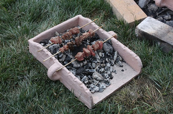 Cooking experiments suggest that Mycenaean souvlaki trays would have been portable. Credit: Julie Hruby